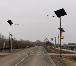 New solar powered street lighting and yellow beacon lights.